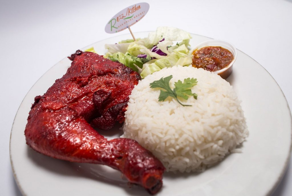 Chicken tandoori served with penyet sambal and rice.