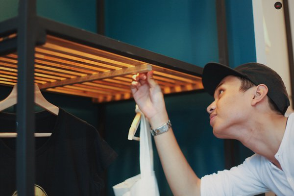 Wa'iz checking out a simple yet unconventional clothes rack he designed. Picture: Hj Safwan