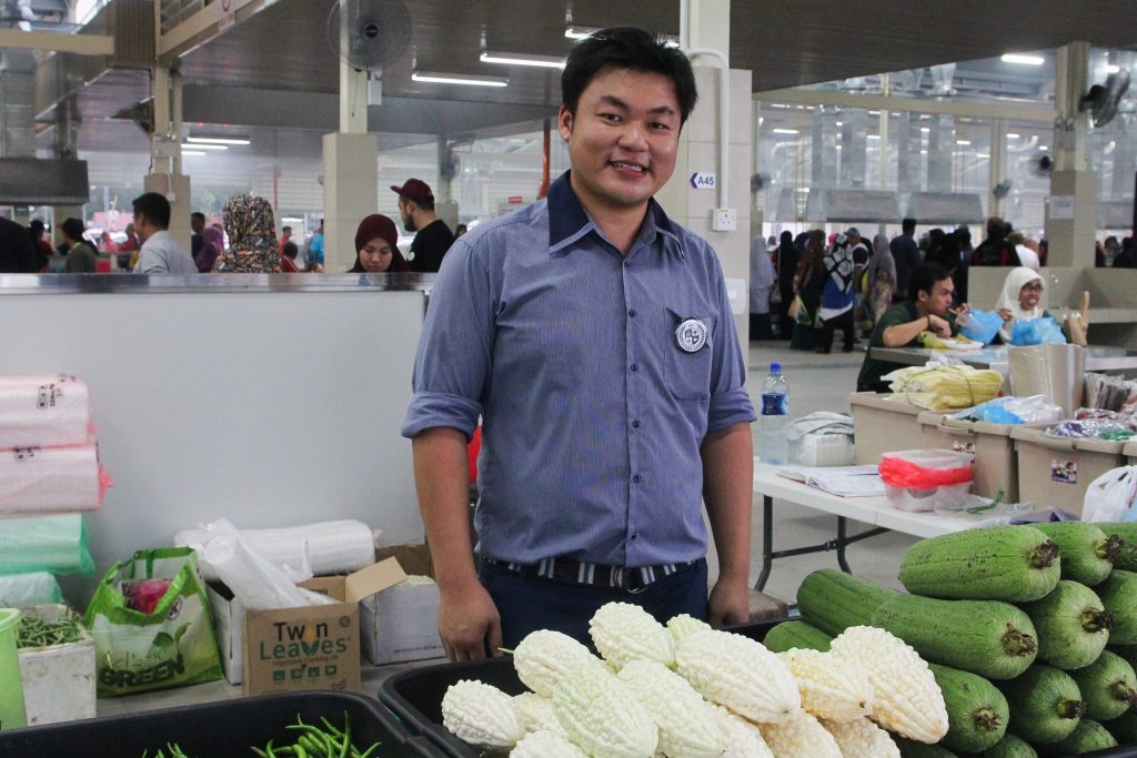 Javen Sui Soon Seng with is organic produce yesterday at the Gadong night market